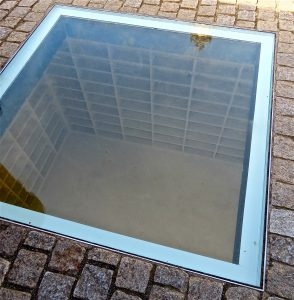 The empty shelves memorial below Bebelplatz includes a plaque bearing Heine's famous words.