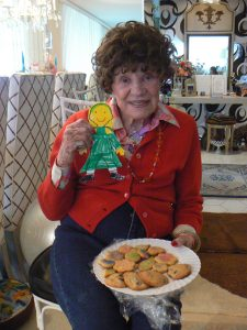 "At close to 90, Rosi was still helping students--here with a ""Flat Stanley"" project--and enjoying her favorite sweets"